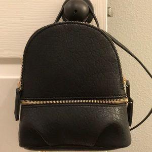 Zara mini convertible backpack.
